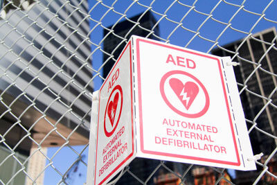 Automatic external defibrillators are now widely available in public places. (This one's at the September 11 memorial in New York.) If you're having a heart attack in a mall or school, for example, have someone look for an AED in case you need it.